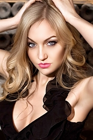 Ukrainian girl Anastasia,28 years old with grey eyes and blonde hair.