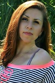 Ukrainian girl Tanya,30 years old with brown eyes and dark brown hair.