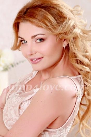 Ukrainian girl Julie,41 years old with blue eyes and blonde hair. Julie