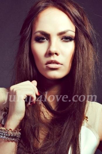 Ukrainian girl Julia,25 years old with green eyes and dark brown hair. Julia