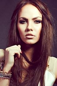 Ukrainian girl Julia,25 years old with green eyes and dark brown hair.