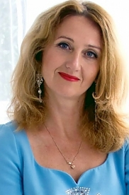 Ukrainian girl Vika,48 years old with grey eyes and light brown hair.