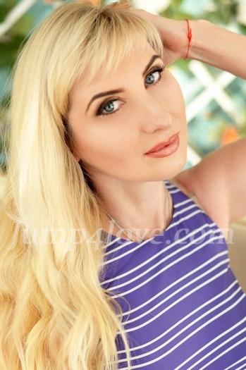 Ukrainian girl Nataliya,48 years old with blue eyes and blonde hair. Nataliya